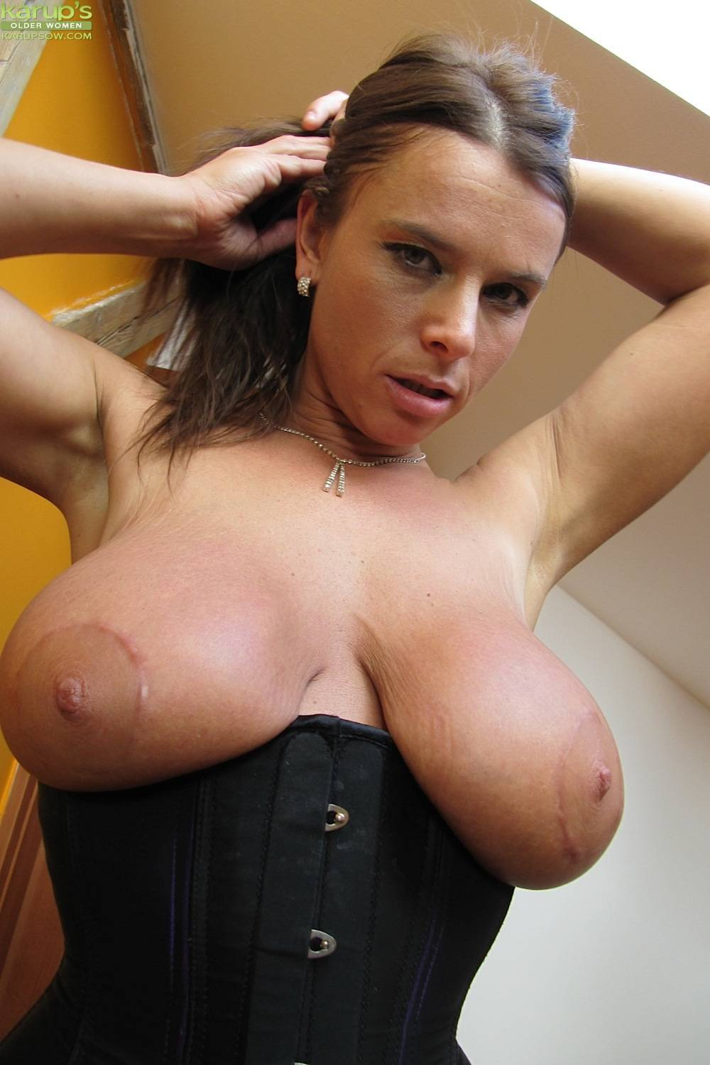 Susanne has a huge tits and a big pussy that she loves to expose at Karupsow