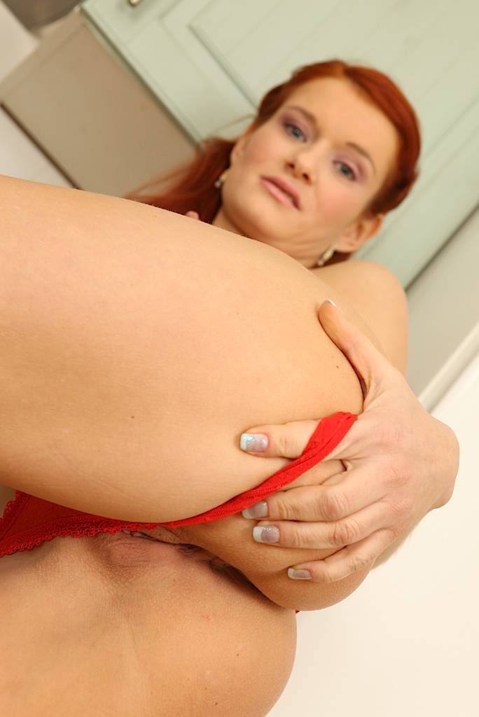 Sexy Mature Redhead Lucy Red Fingers Pussy In The Kitchen. At Karupsow