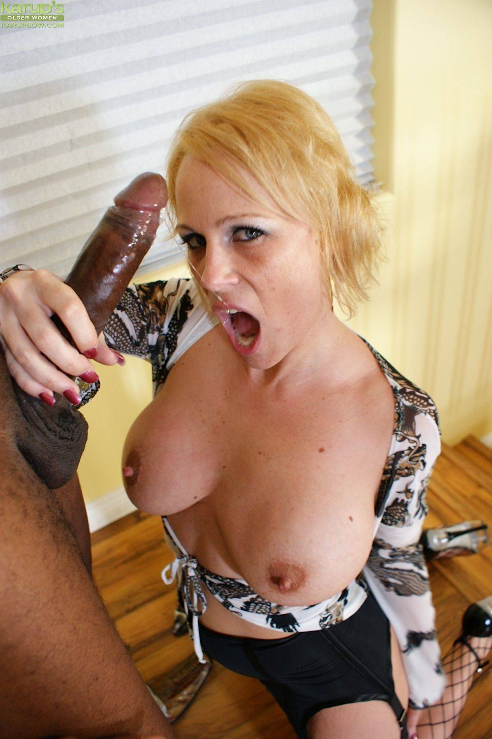 Busty cougar Sunny Day takes that big black cock hard at Karupsow