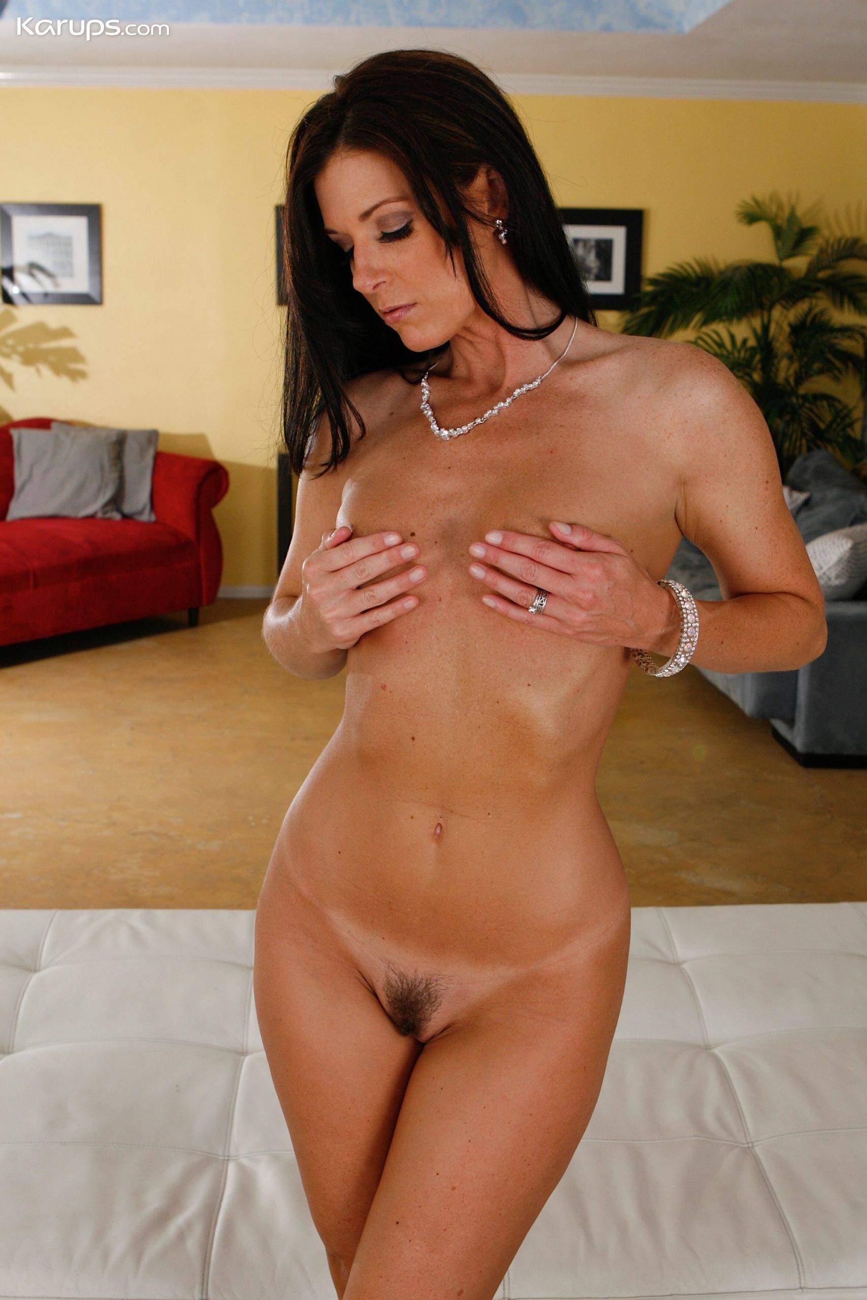 Brunette MILF India Summer wearing only her black heels at Karupsow
