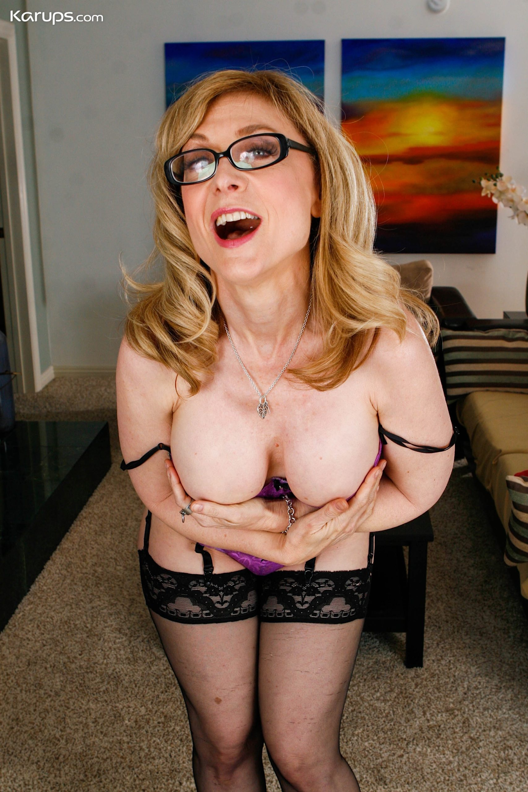 Busty mature cougar Nina Hartley in sexy black stockings at Karupsow