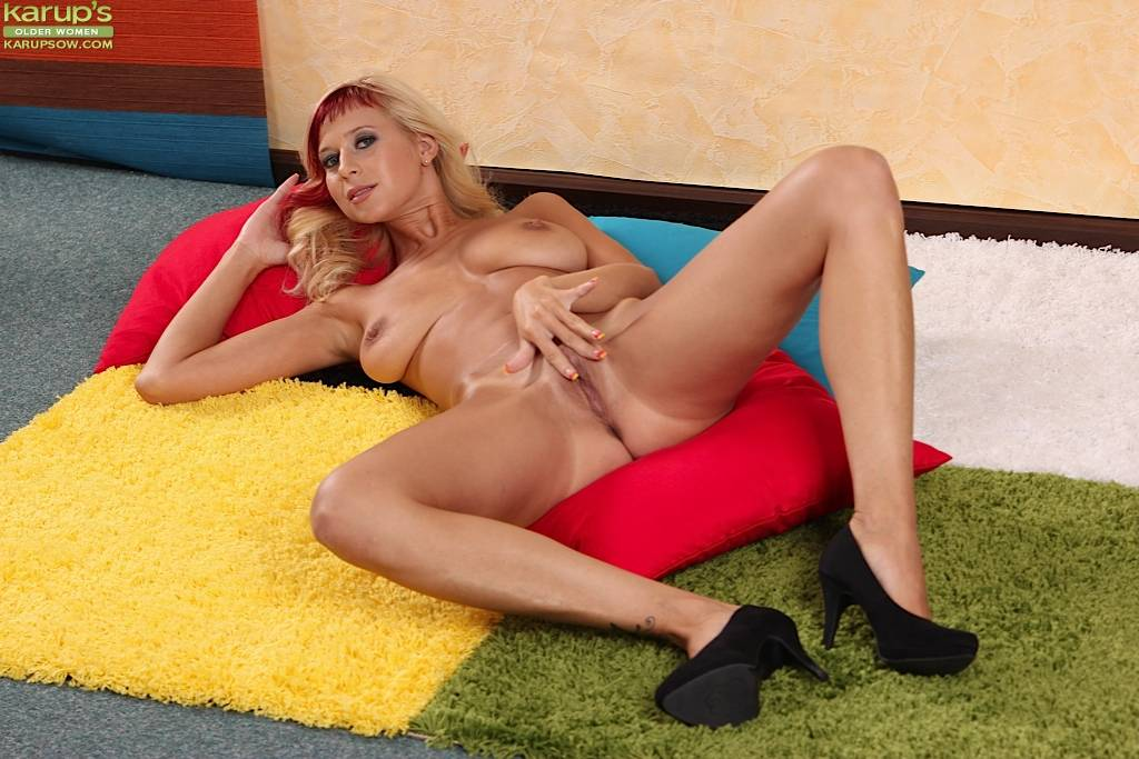 Spunky MILF Anastasia Devine licks her perky tits at Karupsow
