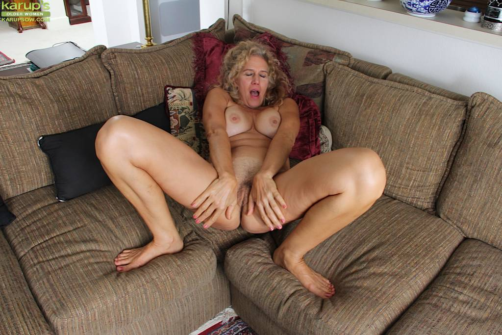 Busty Blonde Housewife Cally Jo Fingers Her Pussy On The Sofa At Karupsow