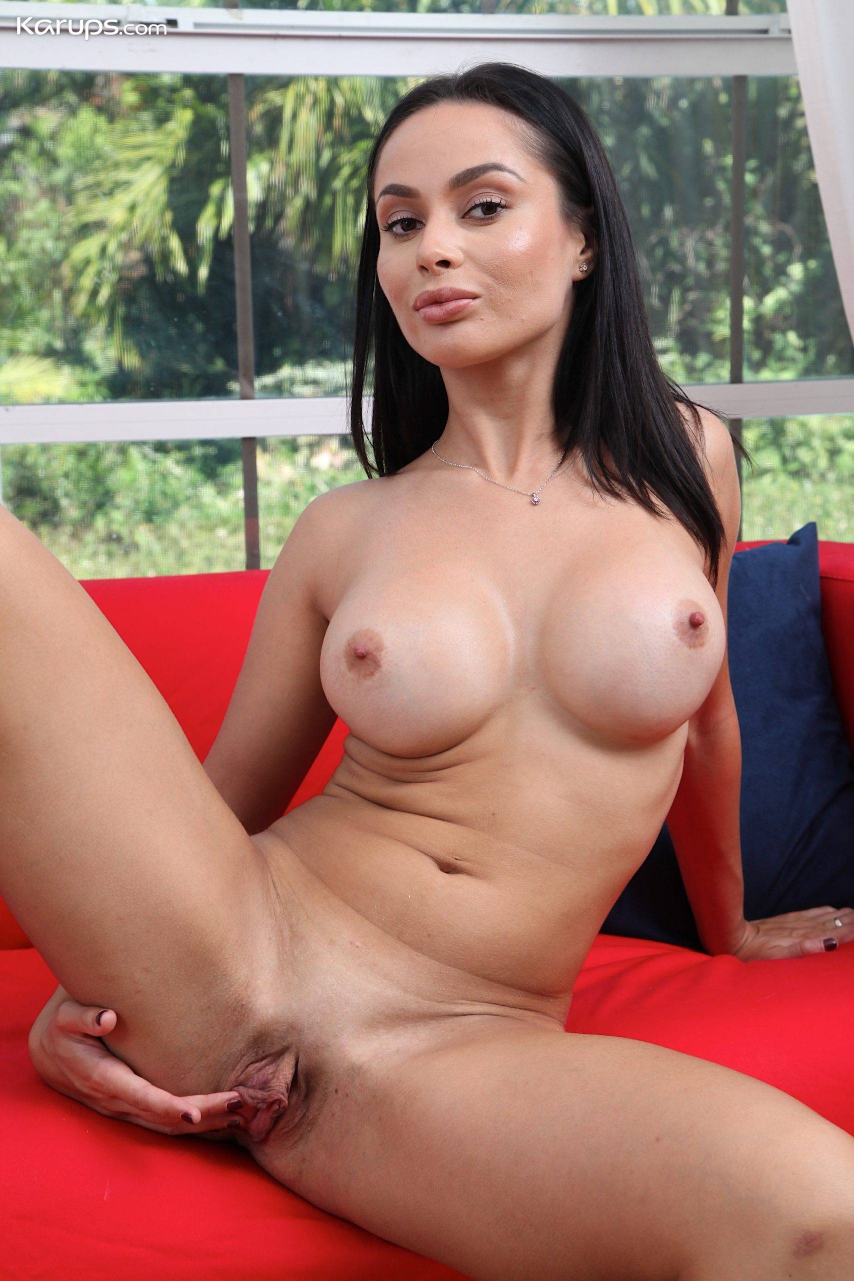 Busty MILF Crystal Rush with her legs behind her head at Karupsow