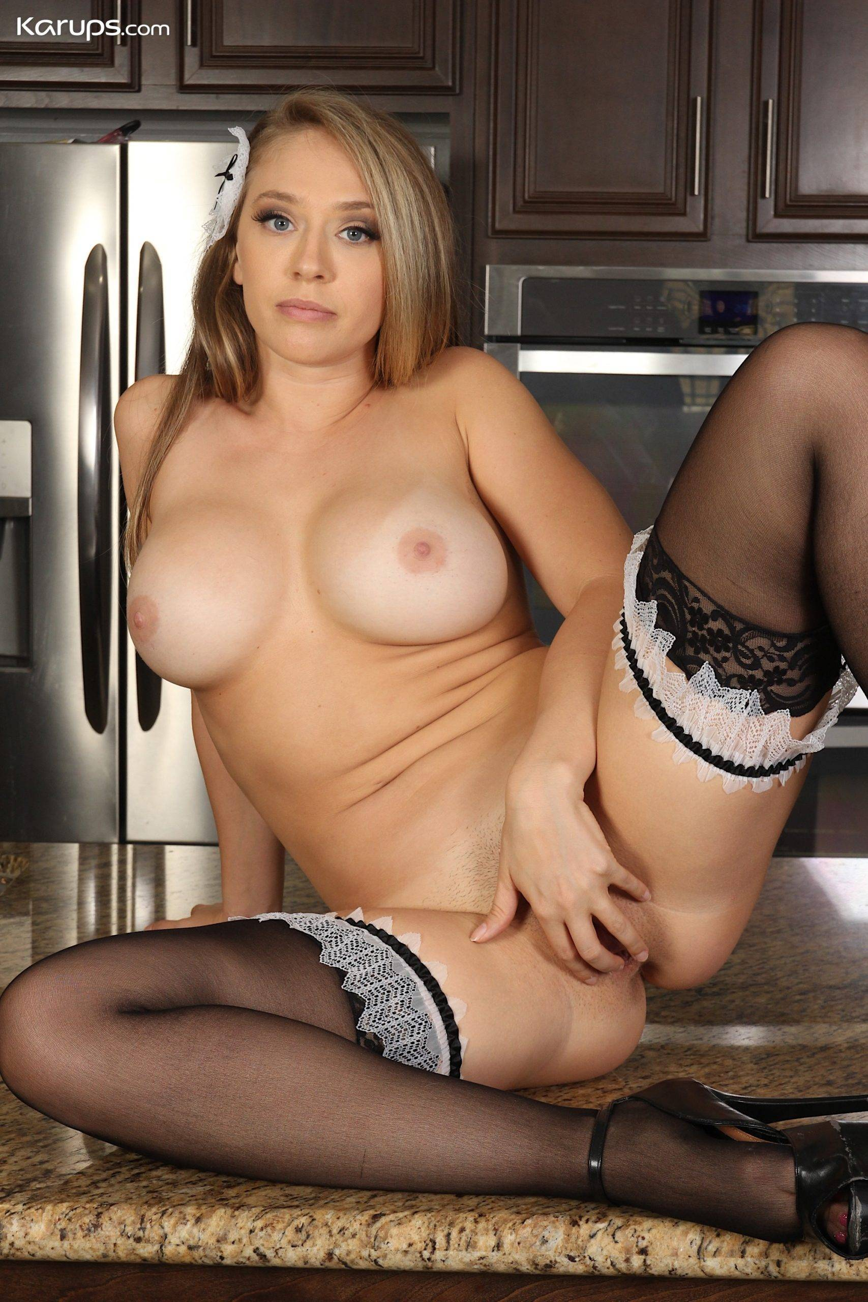 Sexy French maid MILF Kagney Lynn Karter strips in the kitchen at Karupsow