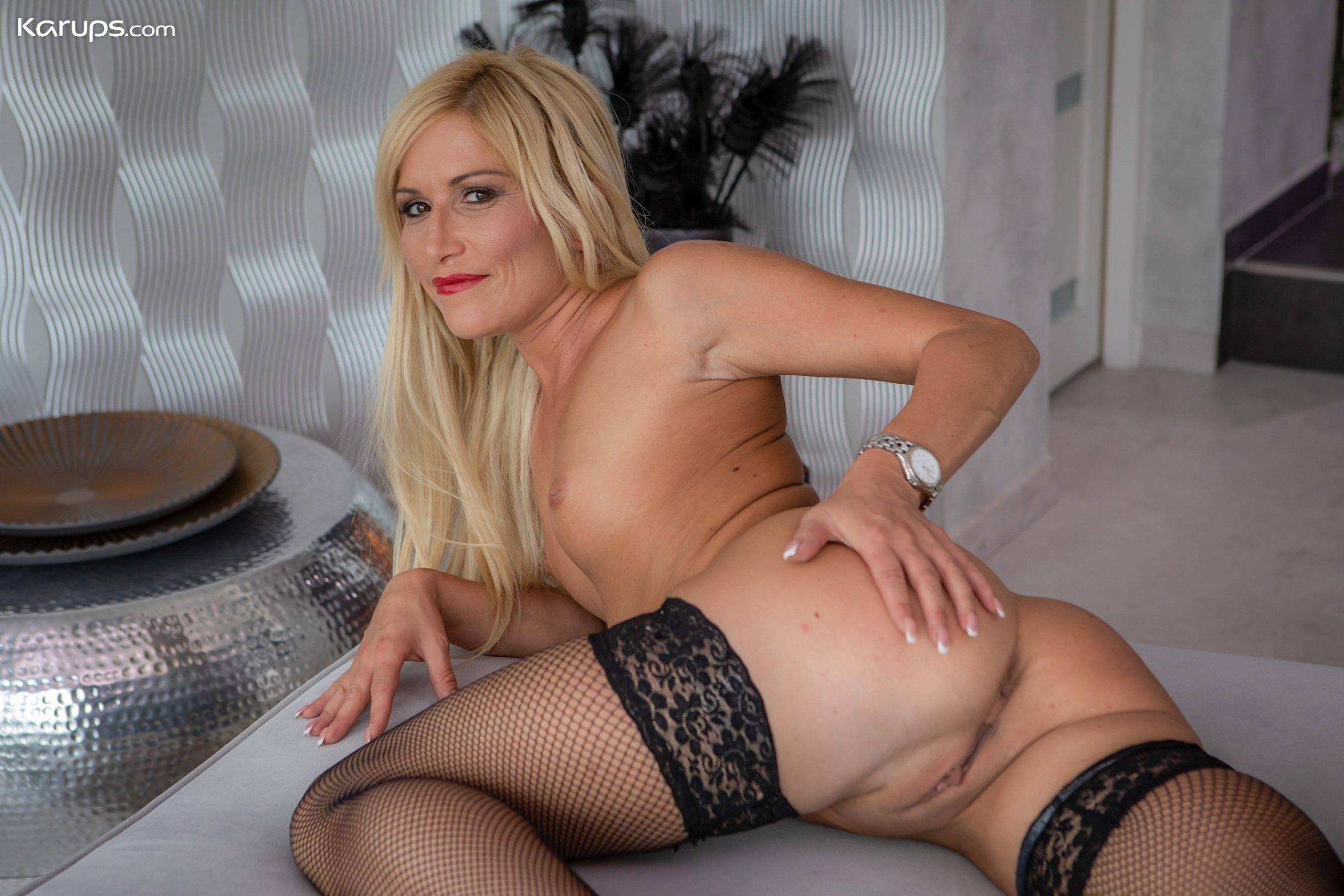 Stunning blonde MILF Black Blondie naked in only black stockings at Karupsow