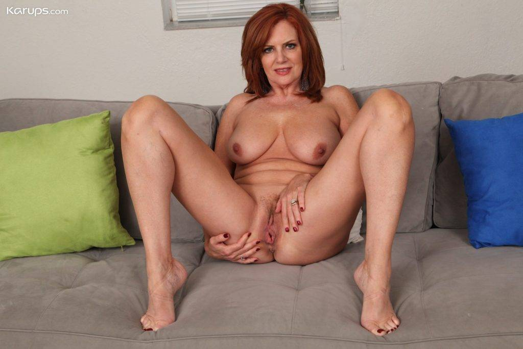 Mature Redhead Andi James Slowly Strips Naked On The Sofa At Karupsow