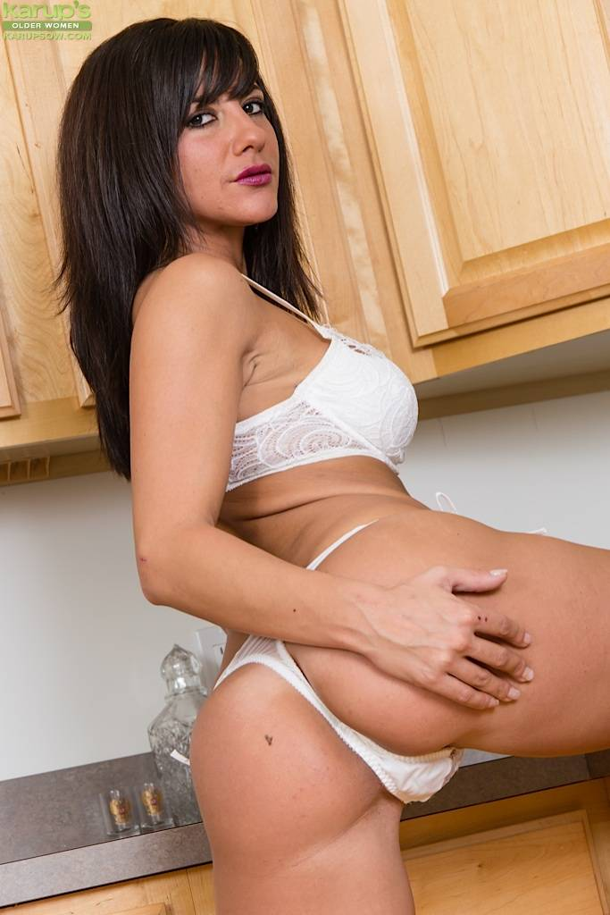 Busty Milf Mackenzie Marie Strips Naked In Kitchen At Karupsow