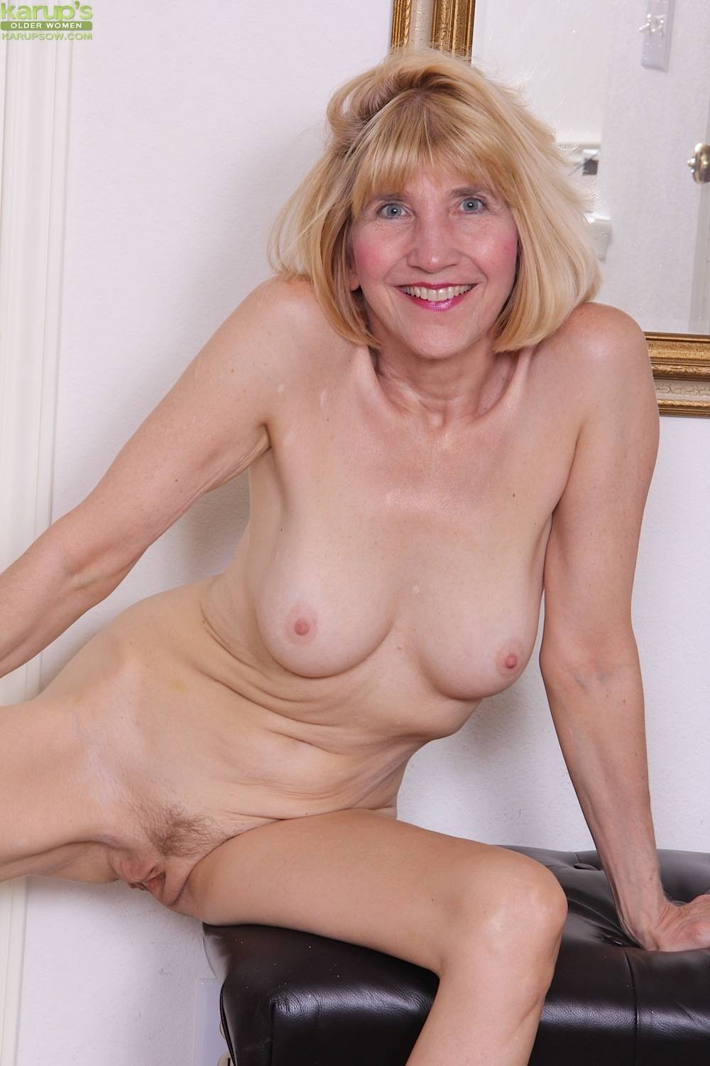Horny business woman Bossy Ryder strips after work at Karupsow