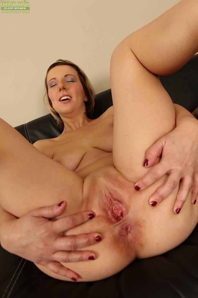 Blonde Milf Luci Angel Masturbating On The Black Sofa At Karupsow