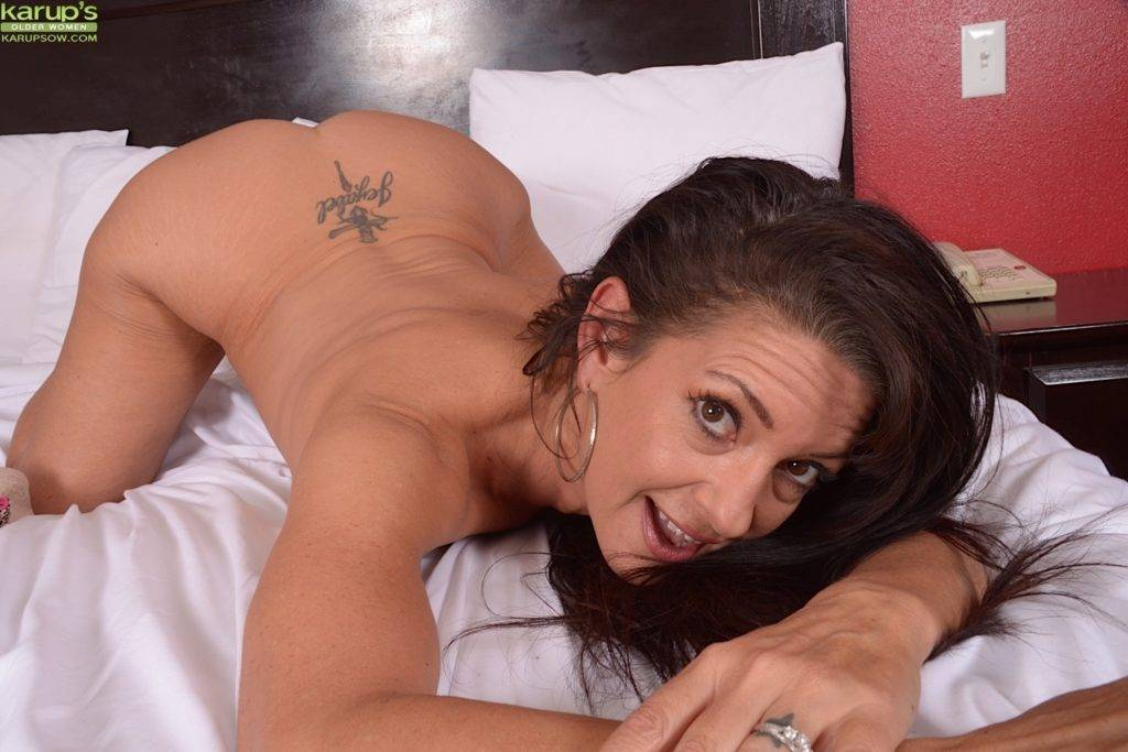 Mature Babe Gabriella Lane Wonders If You Could Cum On Her Tramp Stamp At Karupsow