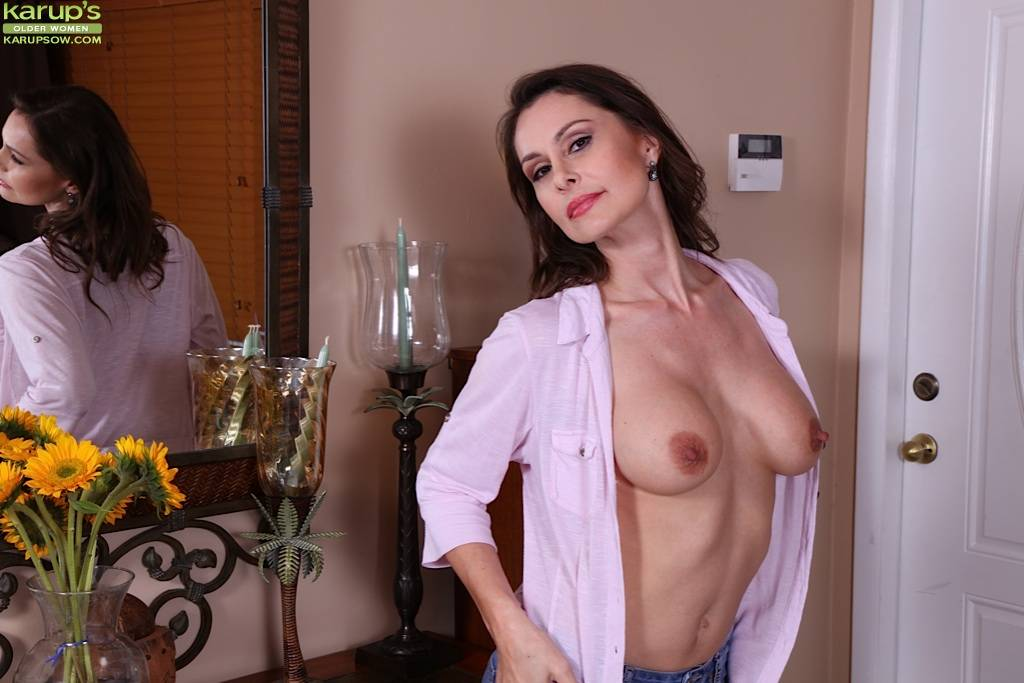Mature Brunette Nora Noir Slips Out Of Her Blue Jeans At Karupsow