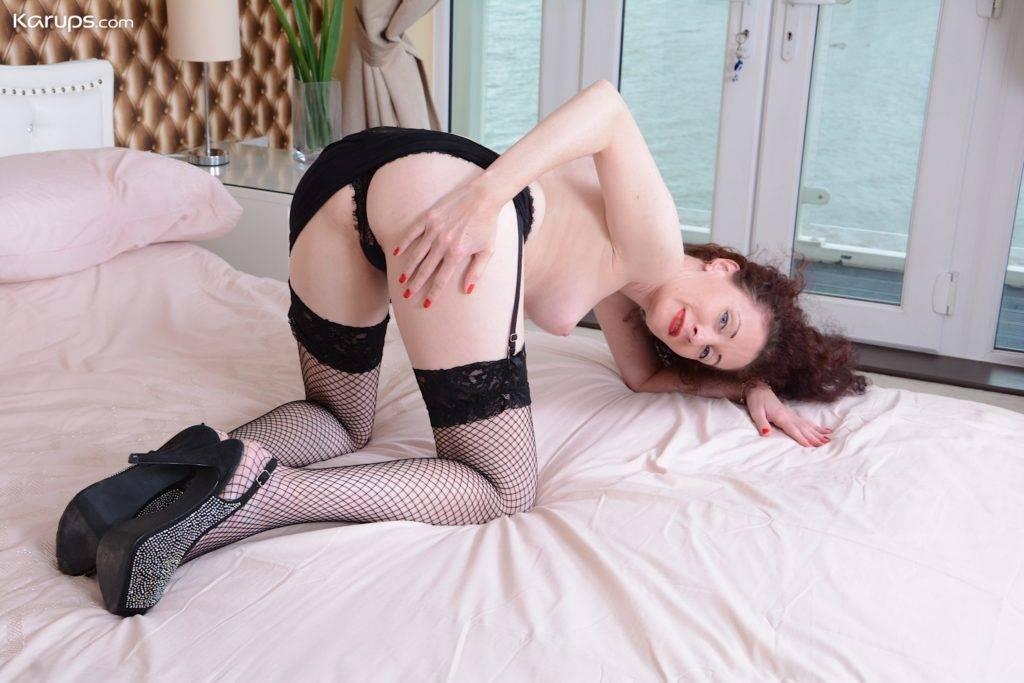 Older Amateur Scarlett Martini Straddles Black Panties Between Her Ankles At Karupsow