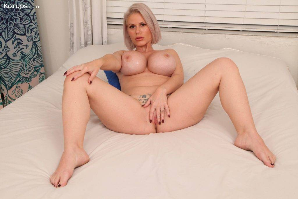 Blonde Milf Casca Akashova Exposes Massive Tits And Fingers Her Twat At Karupsow
